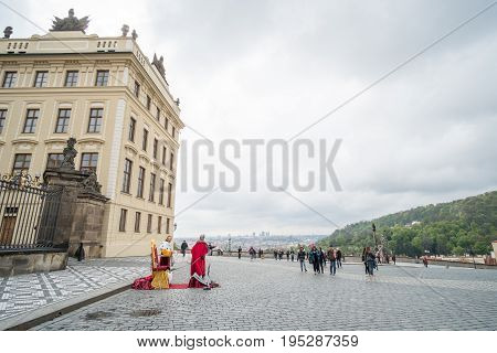 Prague, Czech Republic - 18 April 2017: Tourists In Front Of Prague Castle Entrance, Is A Castle Com