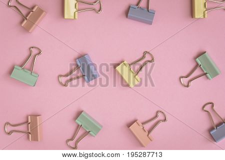 Flat Lay Colorful Paper Clip Pattern On A Pink Paper