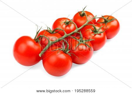 Bright red fresh tomatoes with leaves, isolated on a white background. Tasty, ripe, juicy, fresh and organic red cherry tomatoes. Healthy vegetables. Tomatoes full nutritious vitamins.