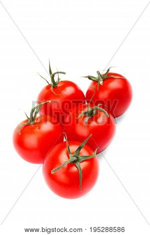 A lot of a fresh, healthy, ripe red tomatoes, isolated on a white background. Whole juicy, raw, tasty bright red tomatoes. Healthy vegetables. Tomatoes full nutritious vitamins.