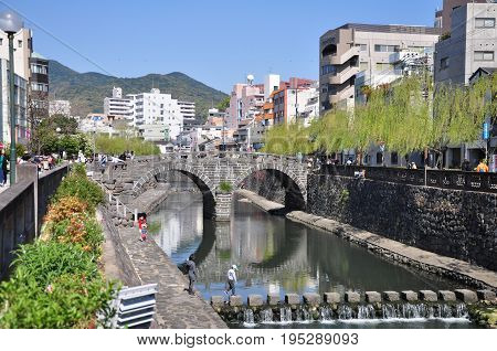 Nagasaki, Japan - April 6, 2014:Megane Bridge or Spectacles Bridge is an old stone arch bridge constructed over the Nakashima River in Nagasaki, Kyushu, Japan. The bridge was originally built in 1634.