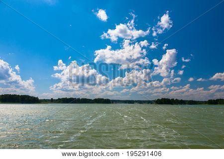 Deep blue cloudy sky over Sniardwy Lake, Mazurien Region, Poland, Europe