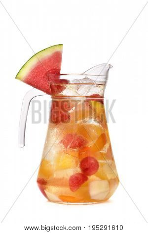 a glass pitcher with refreshing spanish sangria blanca, white sangria, with pieces of fresh fruit, on a white background