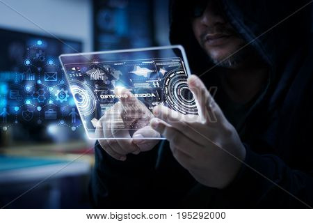 Hacker using clear tablet with HUD panel and code graph bar data analytsis element for cyber technology concept dark and grain process shallow depth of field select focus on hands