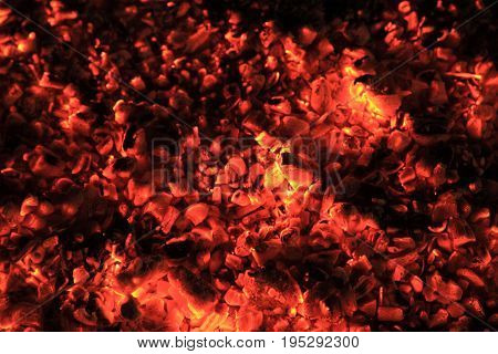 Close Up of red hot coals and embers in fare burning heat wood
