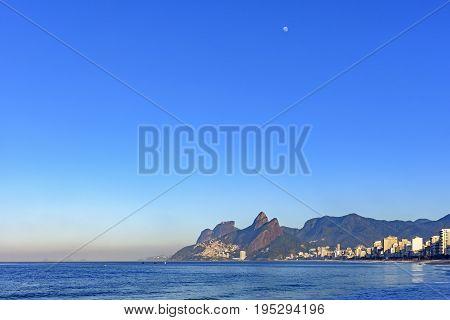 Moon over Ipanema beach in Rio de Janeiro at morning