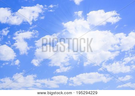 Sky background on sunset. Nature composition. Panoramic sunset sky background. Sunrise sky with lighted clouds. Beautiful sunset over sea with reflection in water, majestic clouds in the sky.