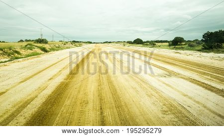 Sandy road surface tracks in Mozambique, Africa