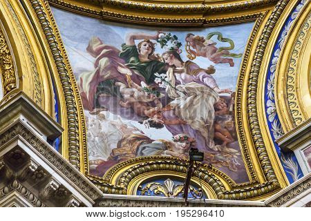 ROME, ITALY - JANUARY 18, 2017 Saint Agnese Painting Saint Agnese In Agone Church Basilica Dome Rome Italy. Church built in 1652. Saint Agnese is a Christian martyr who in 304 AD was exposed naked to force her to renounce her faith. Later she was killed.