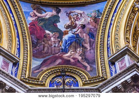 ROME, ITALY - JANUARY 18, 2017 Women Painting Saint Agnese In Agone Church Basilica Dome Rome Italy. Church built in 1652. Saint Agnese is a Christian martyr who in 304 AD was exposed naked to force her to renounce her faith. Later she was killed. Took pl