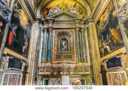 ROME, ITALY - JANUARY 18, 2017 Mary Shrine Christian Paintings Santa Maria Della Pace Church Basilica Rome Italy. Church built in 1400 and 1500s by Pope Sixtus IV on the spot where a painted Madonna was pierced and blood came out.