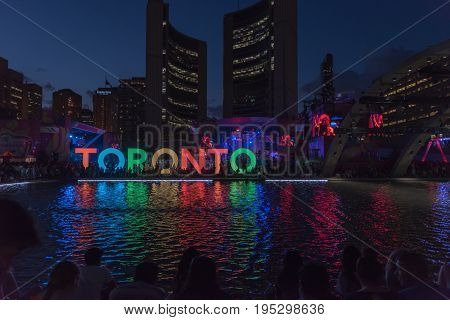 TORONTO - July 19 2015: Toronto sign on Nathan Phillips Square in Toronto Ontario Canada. The 3D TORONTO sign or simply the Toronto sign is an illuminated three-dimensional sign