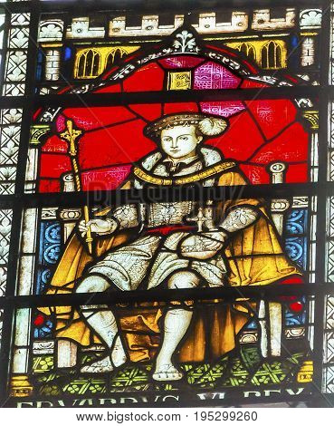 LONDON, ENGLAND - JANUARY 16, 2017 King Edward Vi Stained Glass 13th Century Chapter House Westminster Abbey Church London England. King Edward VI Son of Henry VIII ruled England from 1537 to 1553 Westminister Abbey has been the burial place of Britain's