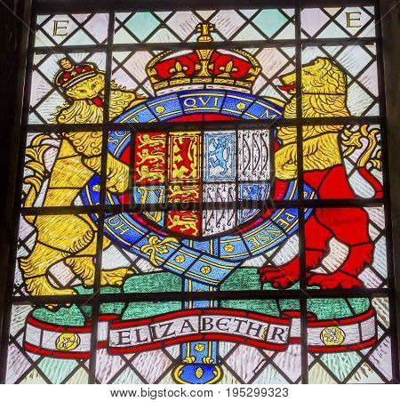 LONDON, ENGLAND - JANUARY 16, 2017 Elizabeth 1 Coat of Arms Stained Glass 13th Century Chapter House Westminster Abbey Church London England. Westminister Abbey has been the burial place of Britain's monarchs since the 11th century and is the setting for