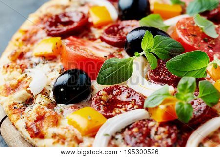 Pizza with pepperoni and vegetables