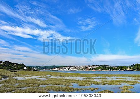 Bideford North Devon England 13th July 2017 - The town and old bridge in the port of Bideford in North Devon England looking west across the river Torridge. The MV Oldenburg to Lundy Island is berthed taken from the Tarka Trail.