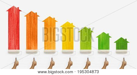 energy efficiency concept hands with paint roller painting the colored class home and arrow chart isolated on white background