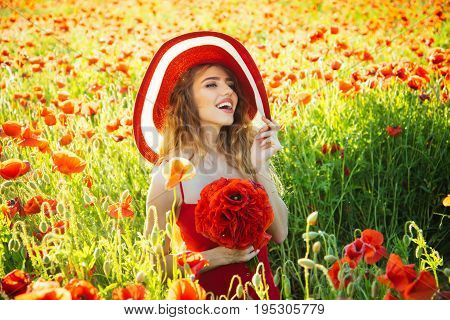 Woman In Field Of Poppy Seed In Retro Hat