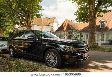 KEHL GERMANY - JUL 14: 2016: Mercedes-Benz estate wagon car parked in center of typical German village city. Mercedes-Benz is a global automobile manufacturer and a division of the German company Daimler AG. Mercedes-Benz E-Class Mercedes-Benz CLS-Class