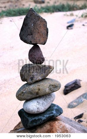 Six Stones In Precarious Balance In The Beach