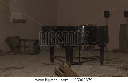Abandoned Piano in Devastated Room in Ghost City of Pripyat in Chernobyl Exclusion Zone