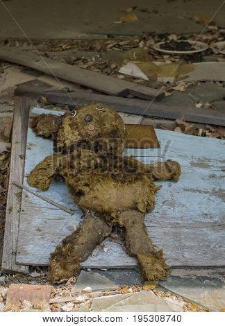 Abandoned Doll in Derelict House in Ghost City of Pripyat in Chernobyl Exclusion Zone