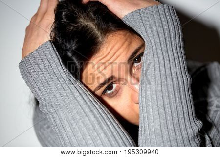 people, grief and domestic violence concept - close up of unhappy woman sitting on floor and crying