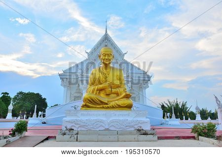 Golden stone statue of a Buddha temple on white temple background in Thailand.