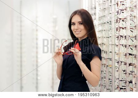 Woman Holding Her Glasses in Medical Optical Store