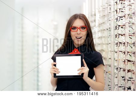 Surprised Woman with PC Tablet in Medical Optic Store