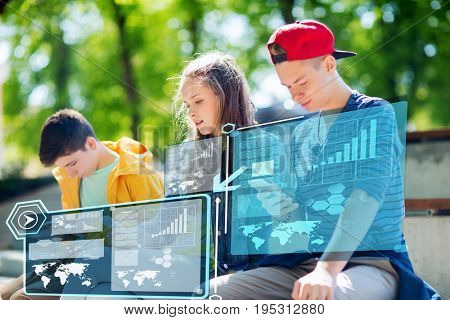 technology, internet addiction and people concept - teenage friends with smartphones outdoors