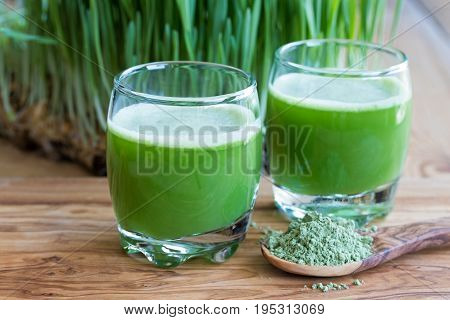 Two Barley Grass Shots On A Wooden Background