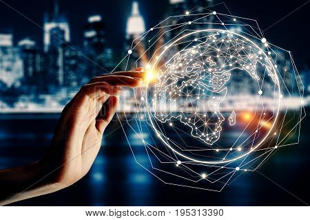 Hand with abstract globe on blurry night city background. Digital global ommunication concept. Double exposure