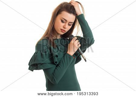 Cutie girl with microphone in green dress isolated on white background