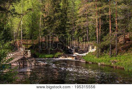 Waterfall on the Tohmajoki River. Republic of Karelia, Russia, Ruskeala. The source of the Tohmajoki River is in Finland - Lake Tohmajarvi.