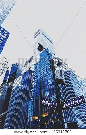 NEW YORK NY - December 03 2016: detail of Mahnattan's streets and skyscapers with Madison Aenue street sign