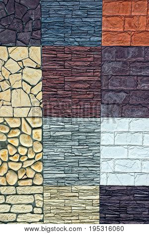Bright colored texture from the wall of colored bricks and stones