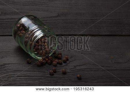 Black Pepper Grinder And Spice On Black Table.