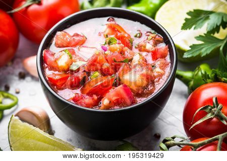 Traditional Latin American mexican salsa sauce and ingredients. Tomato garlic chilly lime and herbs.