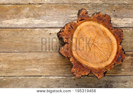 Freshly Cut Hardwood Cross Section Of Tree Showing Growth Lines On Old Wooden Timber Background