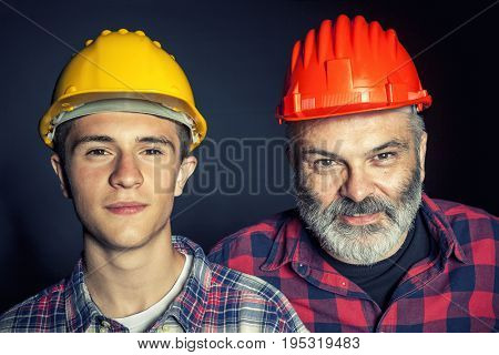 father and son with constructor protection helmet
