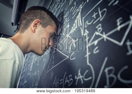 teenage student and blackboard concept of stress