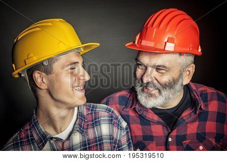 concept of family industry father and son with protection helmet