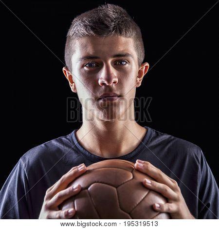 portrait of soccer player on black background