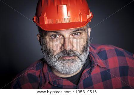 portrait of constructor with beard studio shot