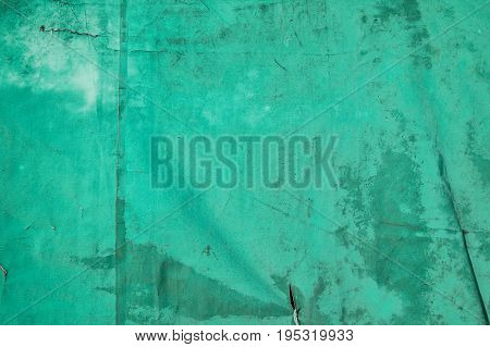 Old distressed, green canvas cover abstract background