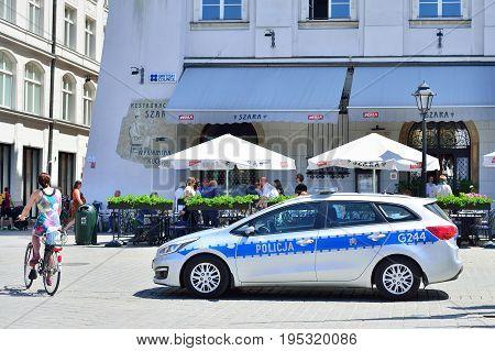 KRAKOW POLAND - JUNE 2017: Patrol police car in the Krakow Square.