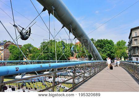KRAKOW POLAND - JUNE 2017: Modern footbridge during sundown in Krakow Poland Europe.