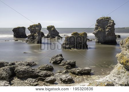 Sea Stacks at Gotland Sweden with a clear blue sky.