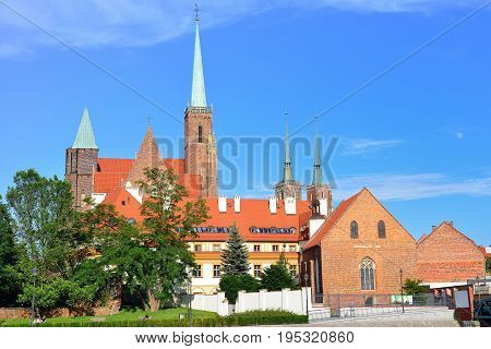 Picturesque scene of famous Tumski island with cathedral of St. John on Odra river. Colorful spring landscape in Wroclaw Poland Europe.